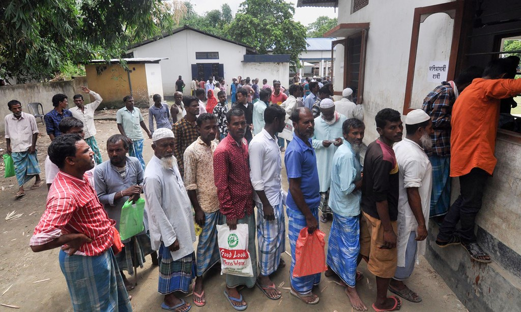 Morigaon: People stand in a queue to check their names on the final list of the National Register of Citizens (NRC) outside a Gaon Panchayat office in Pavakati village, Morigoan, Saturday, Aug 31, 2019. (PTI Photo) (PTI8_31_2019_000075B)