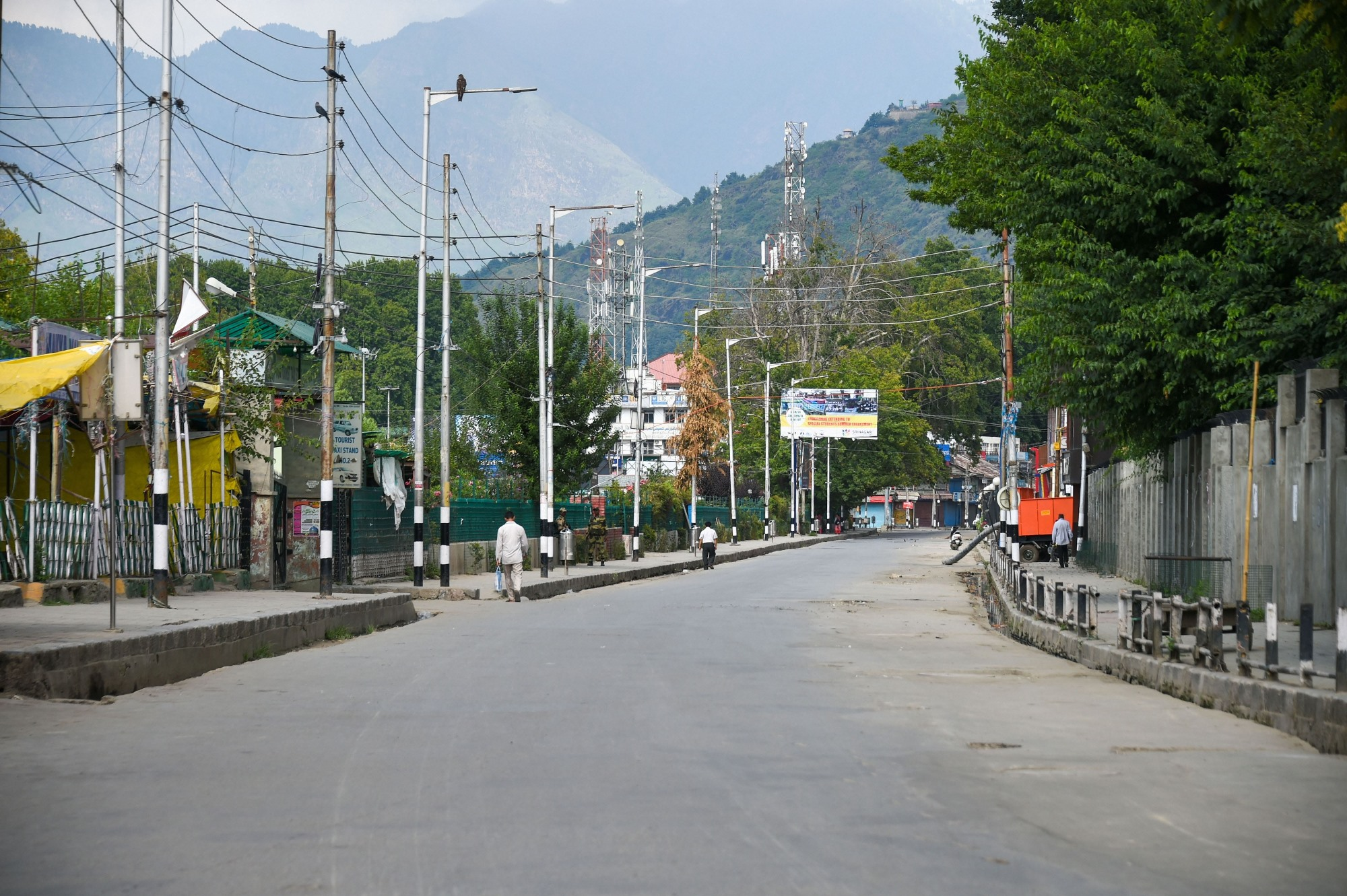 **EDS: RPT WITH DATE CORRECTION** Srinagar: A view of a deserted street during restrictions in Srinagar, Wednesday, Aug 7, 2019. Restrictions have been imposed in several districts of Jammu and Kashmir as a precautionary measure after the state lost its special status and was bifurcated on Tuesday as Parliament approved a resolution scrapping Article 370 of the Constitution and passed a bill to split the state into two Union Territories. (PTI Photo/S. Irfan)(PTI8_9_2019_000010B)