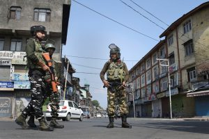 Srinagar: Security personnel stand guard during restrictions and shutdown, in Srinagar, Thursday, Sept. 26, 2019. Normal life remained affected on 53rd consecutive day since 5th August due to restrictions and shutdown, after centre abrogated Article 370 and bifurcated Jammu and Kashmir into two union territories. (PTI Photo/S. Irfan)(PTI9_26_2019_000082B)