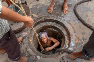 "**EDS: FILE PHOTO** Kolkata: In this ug 10, 2018 file photo, a Municipal Corporation worker enters a manhole for sewage cleaning at Mahatma Gandhi Road, in Kolkata. Slamming the government authorities for not providing protective gear like masks and oxygen cylinders to people engaged in manual scavenging and manhole cleaning, the Supreme Court on Wednesday, Sept. 18, 2019 said this is the ""most inhuman"" way to treat a human being. (PTI Photo)(PTI9_18_2019_000169B)"