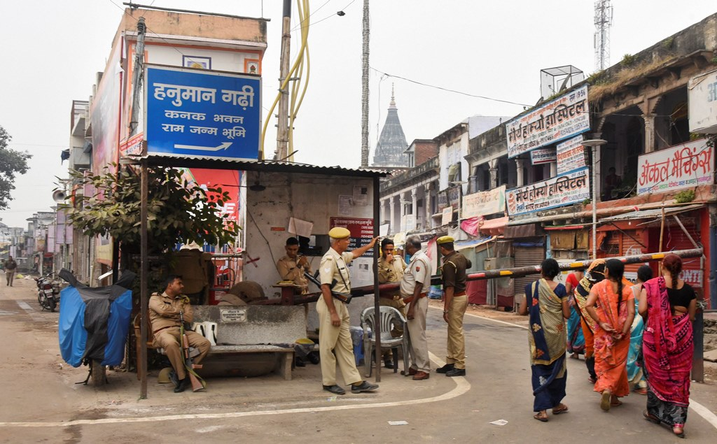 Ayodhya: Police personnel stand guard at a barricade point ahead of 'Deepotsav' festival, in Ayodhya, Wednesday, Oct. 23, 2019. (PTI Photo) (PTI10_23_2019_000031B)