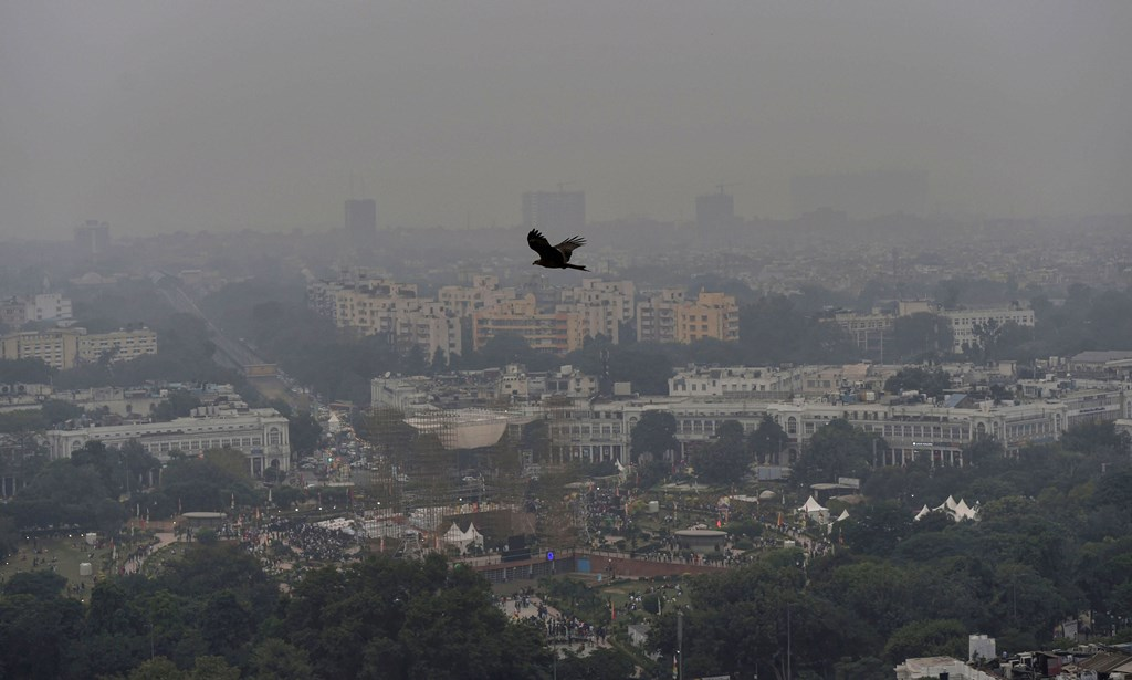 """New Delhi: An aerial view of Connaught Place shrouded in heavy haze post-Diwali celebrations, in New Delhi, Monday, Oct. 28, 2019. Delhi had anticipated the season's worst pollution levels in the morning after Diwali, but the air quality, although """"very poor"""", turned out better than the last three years, according to data of the government's air quality monitors. (PTI Photo/Manvender Vashist)(PTI10_28_2019_000161B)"""