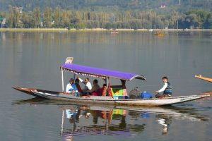Srinagar: Tourists embark on a shikara ride in an empty Dal Lake in Srinagar, Thursday, Oct. 10, 2019. The government has withdrawn its advisory, issued on 2 August, 2019 asking tourists in the Valley to leave. (PTI Photo/S. Irfan)(PTI10_10_2019_000147B)