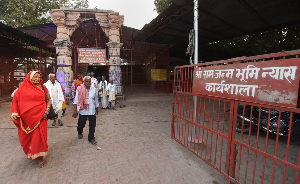 Ayodhya: People during a visit to the Shri Ram Janmbhoomi Nyas Karyashaala (workshop), a day after the Supreme Court's verdict on the Ayodhya case, in Ayodhya, Sunday, Nov. 10, 2019. The apex court has backed the construction of a Ram temple by a trust at the disputed site. (PTI Photo/Nand Kumar) (PTI11_10_2019_000159B)
