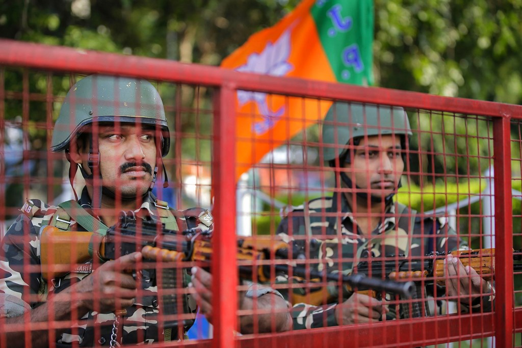 Jammu: Security personnel stand guard along a road in Jammu, Thursday, Oct. 31, 2019. Security has been tightened across Jammu region ahead of bifurcation of Jammu and Kashmir into two union territories which came into existence after midnight. (PTI Photo)  (PTI10_31_2019_000186B)