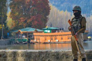 A security person keeps vigil near the Raj Bhawan after bifurcation of the Jammu and Kashmir, in Srinagar on October 31. (Photo: PTI)
