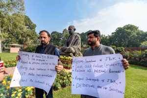 New Delhi: PDP MPs from Jammu and Kashmir Fayaz Ahmad Mir and Nazir Ahmad Laway display placards to protest over Jammu and Kashmir issue on the first day of the Winter Session of Parliament, in New Delhi, Monday, Nov. 18, 2019. (PTI Photo/Atul Yadav)(PTI11_18_2019_000047B)