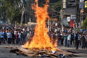 Guwahati: Protestor's burn hoardings and other materials during their march against the Citizenship (Amendment) Bill, 2019, in Guwahati, Wednesday, Dec. 11, 2019. (PTI Photo)