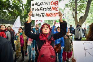 New Delhi: Protestors hold placards during a demonstration against the Citizenship (Amendment) Act, at Mandi House, in New Delhi, Thursday, Dec. 19, 2019. (PTI Photo/Manvender Vashist)(PTI12_19_2019_000118B)