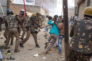 Varanasi: Police personnel baton charge protestors demonstrating against the Citizenship Amendment Act, in Varanasi, Friday, Dec. 20, 2019. (PTI Photo)(PTI12_20_2019_000169B)
