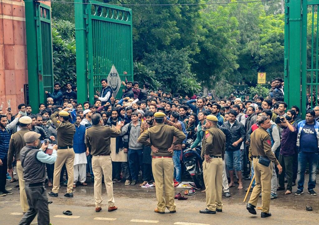 New Delhi: Students ofJamiaMillia Islamia University clash with the police during a protest against the Citizenship Amendment Bill (CAB), at the University in New Delhi, Friday, Dec. 13, 2019. (PTI Photo) (PTI12_13_2019_000264B)