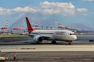 New Delhi: In this file photo dated Aug 15, 2016, water cannon salute is accorded to Air India's 787-800 Dreamliner plane at Newark Airport. Various Air India employee unions met on Monday, Jan. 27, 2020, after the government, earlier in the day, announced the sale of 100 per cent stake in Air India as it issued the preliminary bid document for the strategic disinvestment. (PTI Photo)  (PTI6_29_2017_000164B)(PTI1_27_2020_000120B)