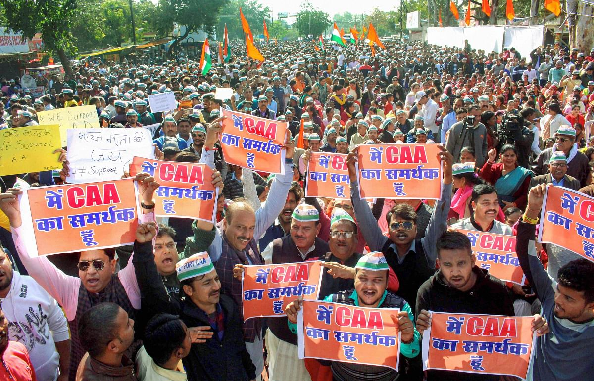 Protesters participate in a rally in support of Citizenship Amended Act (CAA) and National Register of Citizenship (NRC) in Bhopal. (PTI Photo)