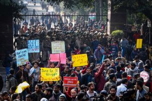 New Delhi: JNU students gather at the entrance gate of the Jawahar Lal University before leaving for their protest march from Mandi House to HRD Ministry, demanding removal of the university vice-chancellor, in New Delhi, Thursday, Jan. 9, 2020. (PTI Photo) (PTI1_9_2020_000199B)