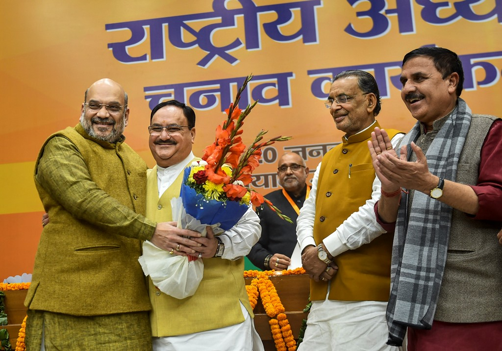 New Delhi: Union Home Minister and outgoing BJP President Amit Shah greets party leader J P Nadda (2nd R) after he was elected as the next national President of the party, in New Delhi, Monday, Jan. 20, 2020. Organisation Poll process incharge Radha Mohan Singh (2nd R) is also seen. (PTI Photo/Arun Sharma)  (PTI1_20_2020_000113B) *** Local Caption ***