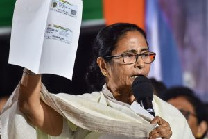 Kolkata: West Bengal Chief Minister Mamata Banerjee shows a document while addressing TMC Chhatra Parshad (TMC students wing) students during their protest dharma against CAA, NPR and NRC in Kolkata, Wednesday, Jan. 15, 2020. (PTI Photo/Swapan Mahapatra) (PTI1_15_2020_000215B)