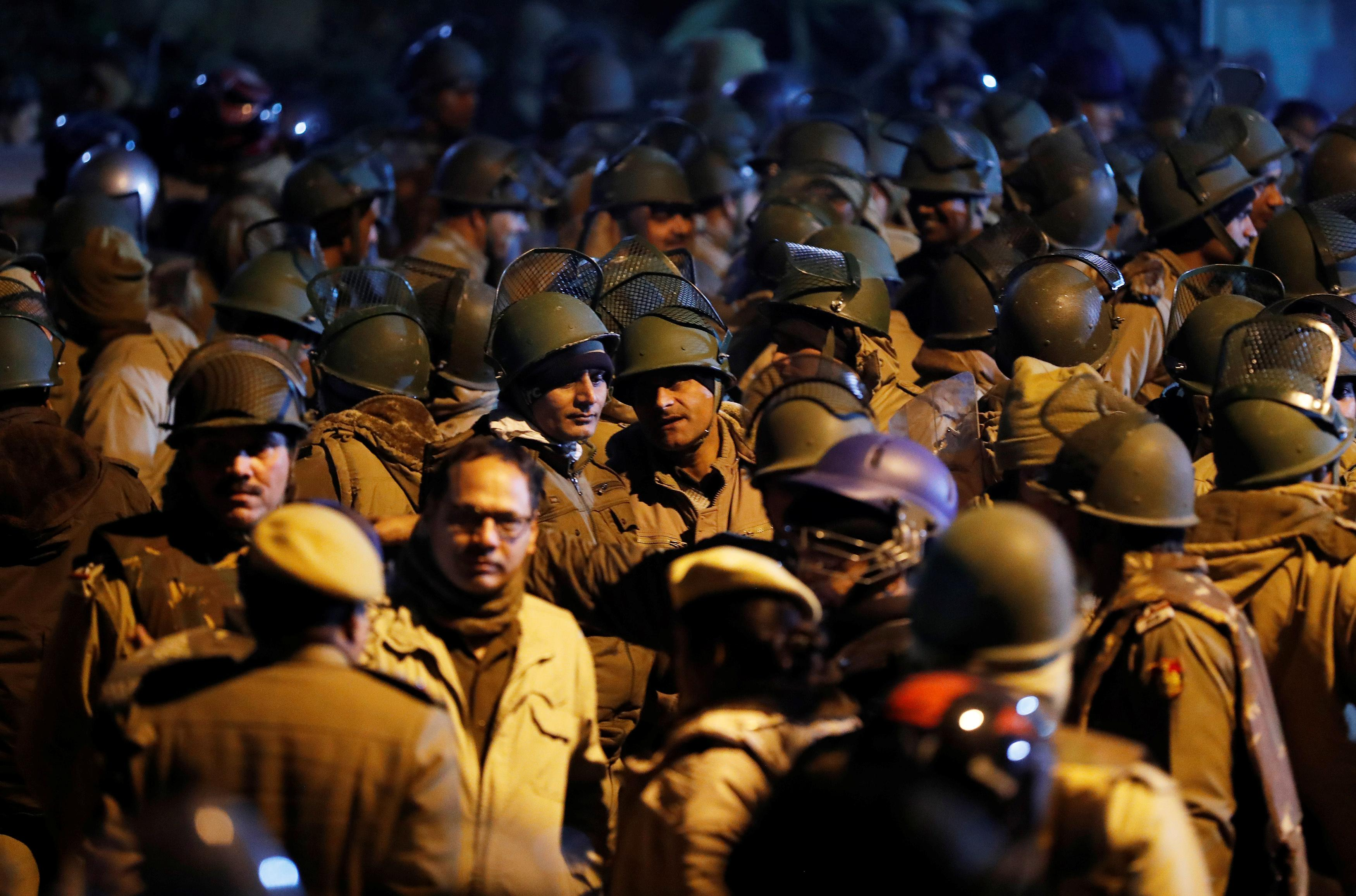 Police in riot gear stand guard outside the Jawaharlal Nehru University (JNU) after clashes between students in New Delhi, India, January 5, 2020. REUTERS/Adnan Abidi