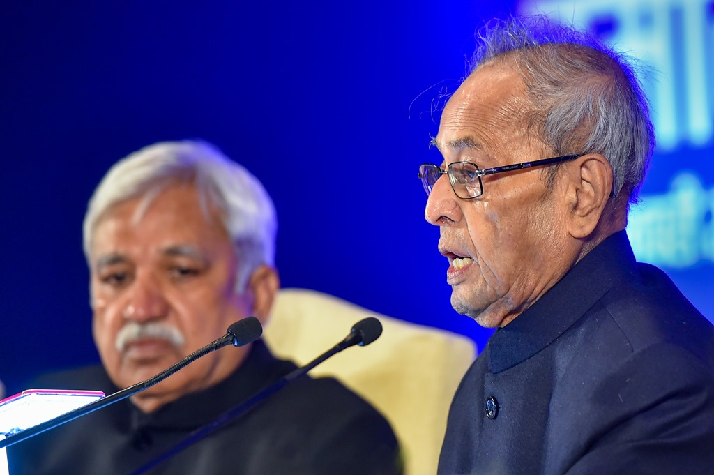 New Delhi: Former president Pranab Mukherjee (R) speaks as Chief Election Commissioner Sunil Arora looks on, during the first 'Sukumar Sen Memorial Lecture series', as part of tribute to India's first Chief Election Commissioner, at Pravasi Bhartiya Kendra in New Delhi, Thursday, Jan. 23, 2020. (PTI Photo/Kamal Kishore)(PTI1_23_2020_000211B)