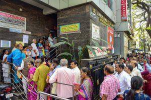 Bengaluru: Depositors stand in queue to withdraw money from Sri Guru Raghavendra Sahakara Bank in Bengaluru, Tuesday, Jan.14, 2020. The Reserve Bank of India (RBI) has curbed Sri Guru Raghavendra Sahakara bank from doing business with immediate effect for alleged irregularities in transactions. (PTI Photo/Shailendra Bhojak)(PTI1_14_2020_000047B)
