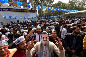 New Delhi: An Aam Aadmi Party worker, dressed as party chief Arvind Kejriwal, celebrates along with others the party's success in the Delhi Assembly polls, at party headquarters in New Delhi, Tuesday, Feb. 11, 2020. (PTI Photo/Manvender Vashist)   (PTI2_11_2020_000086B)