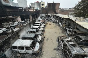 New Delhi: Charred remains of vehicles set ablaze by rioters during communal violence over the amended citizenship law, at Shivpuri area of north east Delhi, Thursday, Feb. 27, 2020.  (PTI Photo/Arun Sharma)(PTI2_27_2020_000030B)