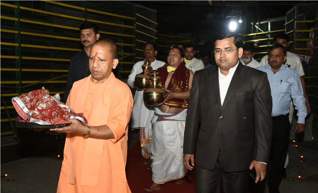 Ayodhya: UP Chief Minister Yogi Adityanath, accompanied by District Magistrate Anuj Jha and priests, shifts the idol of Ramlala from the makeshift temple to a new structure near Manas Bhawan, in Ayodhya, early Wednesday, March 25, 2020. Social distancing was observed, and there was no participation of the public due to the complete lockdown imposed to contain the spread of the novel coronavirus. (PTI Photo) (PTI25-03-2020 000027B)
