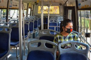 Guwahati: A passenger wears  a protective mask to mitigate the coronavirus pandemic as she sits inside an empty bus, in Guwahati, Thursday, March 19, 2020. (PTI Photo)(PTI19-03-2020_000123B)