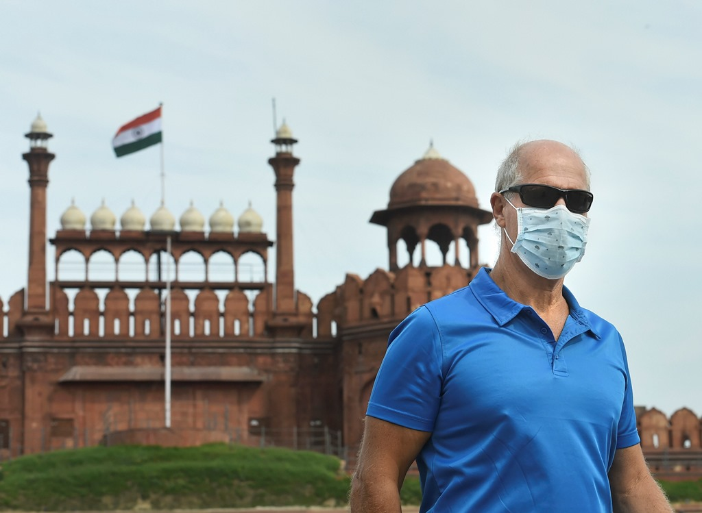 New Delhi: A visitor wears a mask to mitigate the spread of coronavirus, at Red Fort in New Delhi, Thursday, March 12, 2020. (PTI Photo/Arun Sharma)(PTI12-03-2020_000125B)