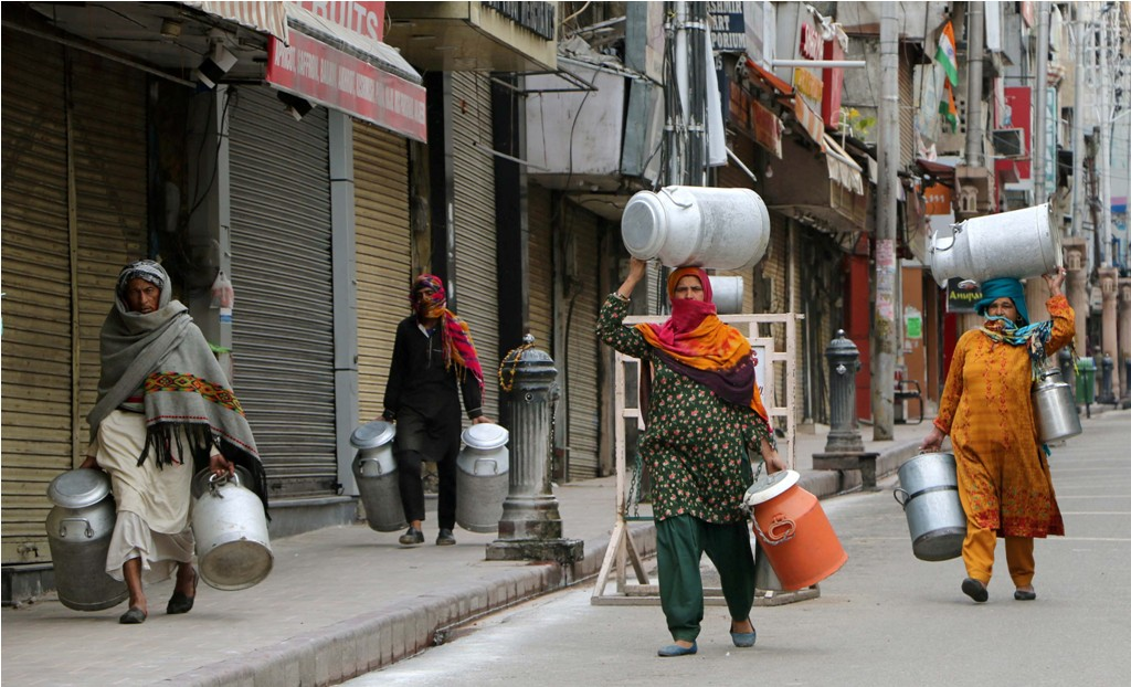 Jammu: Workers carry milk cans on a deserted road during a nationwide lockdown for 21 days in the wake of coronavirus pandemic, in Jammu,Wednesday, March 25, 2020. (PTI Photo)(PTI25-03-2020 000036B)