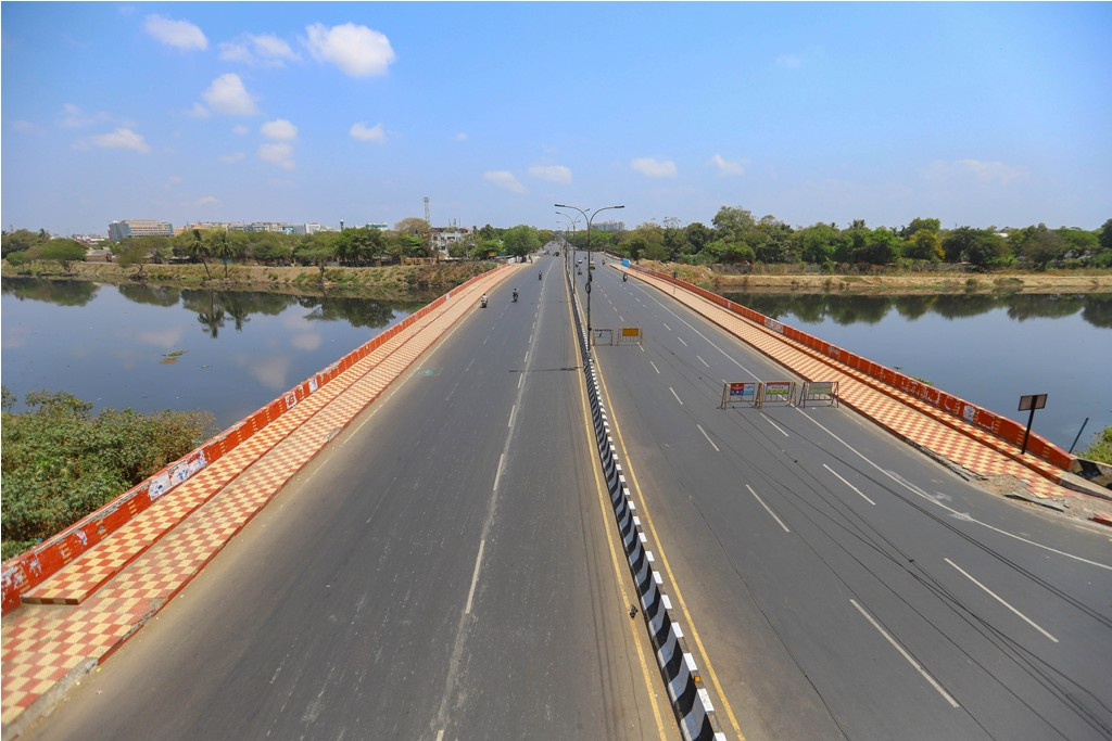 Chennai: Few vehicles are seen on a deserted road during nationwide lockdown amid coronavirus pandemic, in Chennai, Wednesday, March 25, 2020. (PTI Photo)(PTI25-03-2020 000191B)