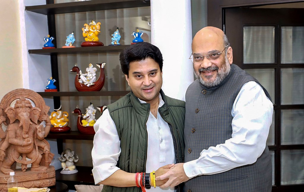 New Delhi: Jyotiraditya Scindia meets Home Minister Amit Shah in New Delhi, Thursday, March 12, 2020, a day after joining the BJP. (PTI Photo) (PTI12-03-2020_000014B)