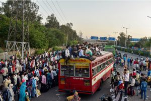 Ghaziabad: Migrants board a bus to their native villages during a nationwide lockdown, imposed in the wake of coronavirus pandemic at Kaushambi, in Ghaziabad, Saturday, March 28, 2020. (PTI Photo/Manvender Vashist) (PTI28-03-2020 000285B)