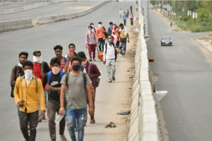 Ghaziabad: A group of migrant workers walk to their villages amid the nationwide complete lockdown, on the NH24 near Delhi-UP Border in Ghaziabad, Thursday, March 26, 2020. The migrants, reportedly, started their journey to their villages in Uttar Pradesh on foot after they were left with no other option following the announcement of a 21-day lockdown across the country to contain the Covid-19, caused by the novel coronavirus. (PTI Photo/Ravi Choudhary)(PTI26-03-2020 000135B)