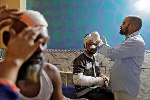 Patient in Al Hind Hospital Delhi Violence Reuters Photo