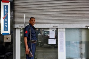A security guard stands outside a closed Yes Bank branch in New Delhi, India, November 9, 2016. (Photo by Cathal McNaughton/Reuters)