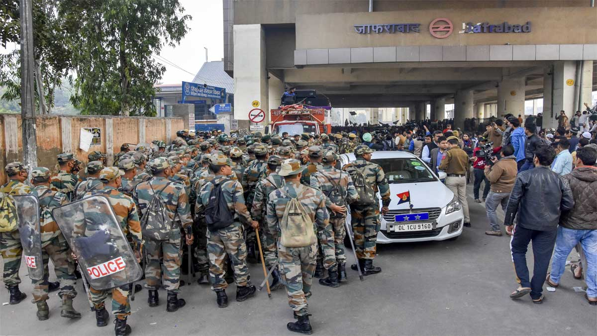 Police personnel deployed outside Jafrabad metro station during protest against CAA and NRC, in New Delhi. (PTI)
