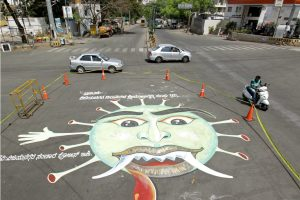 Bengaluru: A coronavirus graffiti drawn at a junction to create awareness during a nationwide lockdown, imposed in the wake of COVID 19 outbreak, in Bengaluru, Thursday, April 2, 2020. (PTI Photo)(PTI02-04-2020 000157B