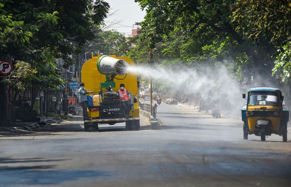 Chennai: Greater Chennai Corporation workers spray disinfectant on a street to mitigate the coronavirus pandemic during a nationwide lockdown, in Chennai, Friday, April 3, 2020. (PTI Photo)(PTI03-04-2020_000209B)