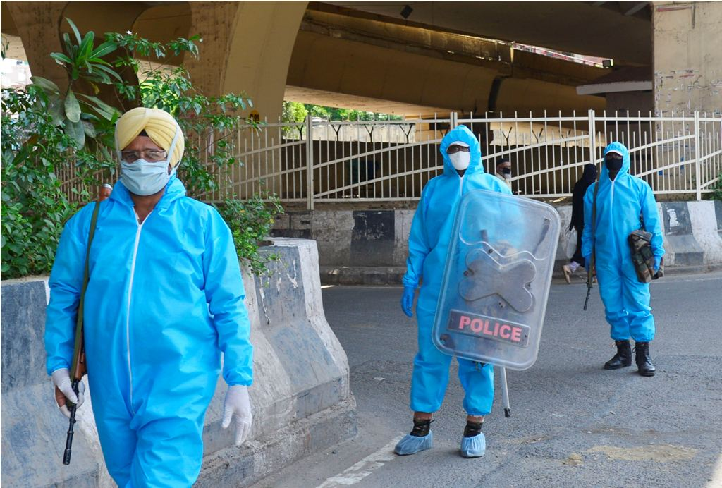 New Delhi: ITBP personnel wearing protective suits patrol a street during a nationwide lockdown as a preventive measure against the coronavirus pandemic, in New Delhi, Wednesday, April 22, 2020. (PTI Photo/Kamal Kishore) (PTI22-04-2020_000098B)