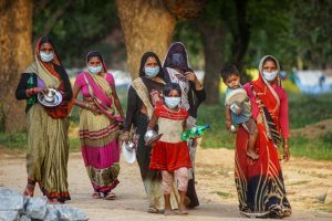 New Delhi: Women arrive to collect food served at a camp during the nationwide lockdown, imposed as a preventive measure against the coronavirus pandemic, in New Delhi, Wednesday, April 22, 2020. (PTI Photo/Kamal Kishore)  (PTI22-04-2020_000232B)