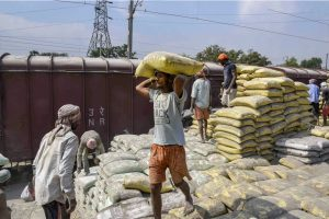 Patna: Labourers unload sacks of cement from a railway goods wagon and load them on trucks for transporting them to different cities during the nationwide lockdown, in wake of the coronavirus outbreak, in Patna, Thursday, April 23, 2020. (PTI Photo)(PTI23-04-2020 000097B)