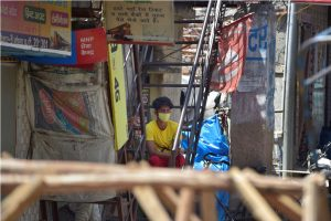 Noida: A boy sits on the staircase of his house, during a nationwide lockdown to curb the spread of coronavirus, at a slum in Noida Sec-8, Wednesday, April 8, 2020. 200 people residing in the slum were taken to a quarantine facility on Tuesday night after they were traced to being in contact with positive COVID-19 patients. (PTI Photo/Vijay Verma)(PTI08-04-2020_000091B)