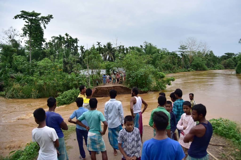 Nagaon: Villagers watch a washed away road after flooding by Borpani River due to incessant rainfall for the past two days, at Madhab Para near Kampur in Nagaon district of Assam, Friday, May 22, 2020. (PTI Photo) (PTI22-05-2020 000084B)
