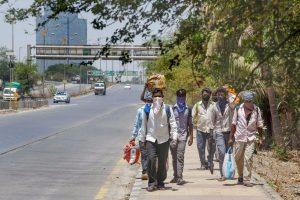 Navi Mumbai: Migrants from Madhya Pradesh walk along a road towards their native places during the nationwide lockdown, imposed in wake of the coronavirus pandemic, in Navi Mumbai, Wednesday, May 6, 2020. (PTI Photo)(PTI06-05-2020_000182B)