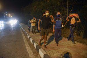 Navi Mumbai: Migrants who were stranded in Panvel walk along a road towards their native places in Uttar Pradesh, during the nationwide lockdown, imposed in wake of the coronavirus pandemic, in Navi Mumbai, Friday, May 8, 2020. (PTI Photo)(PTI08-05-2020_000295B)