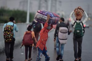 Ghaziabad: Migrants walk on the Delhi-Noida road on their way to their destinations amid rain and storm, during ongoing COVID-19 lockdown in Ghaziabad, Thursday, May 14, 2020. (PTI Photo/Vijay Verma) (PTI14-05-2020_000231B)