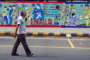 New Delhi: A man walks past wall mural on coronavirus awareness, during the ongoing COVID-19 nationwide lockdown, at Barakhamba Road police station in New Delhi, Thursday, May 7, 2020. (PTI Photo/Manvender Vashist)(PTI07-05-2020_000256B)
