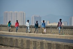 Thane: Migrant workers from Lucknow walk along Mumbai-Nashik highway to reach their native places, during a nationwide lockdown in the wake of coronavirus, in Thane, Wednesday, April 29, 2020. (PTI Photo/Mitesh Bhuvad) (PTI29-04-2020_000060B)