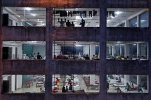 People are seen inside a temporary quarantine centre, during an extended nationwide lockdown to slow the spread of the coronavirus disease (COVID-19), in Kolkata, India, April 15, 2020. REUTERS/Rupak De Chowdhuri