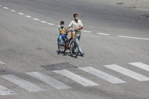Jammu: A man with his child on a bicycle is seen on a deserted road, during a nationwide lockdown in the wake of coronavirus pandemic, in Jammu, Friday, May 01, 2020. (PTI Photo)(PTI01-05-2020_000182B)